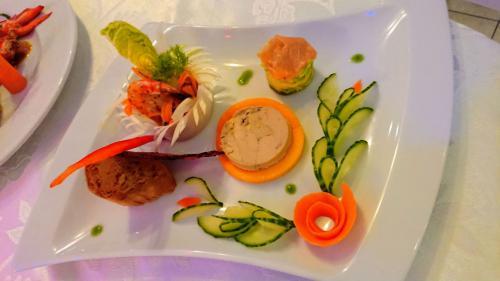 Foie gras sur son lit de mangues grillées